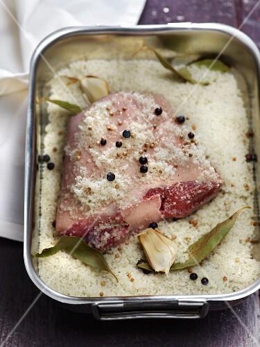 Pork in pickling salt with juniper berries