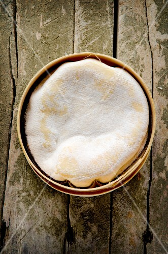 Soft French cheese on a rustic wooden table