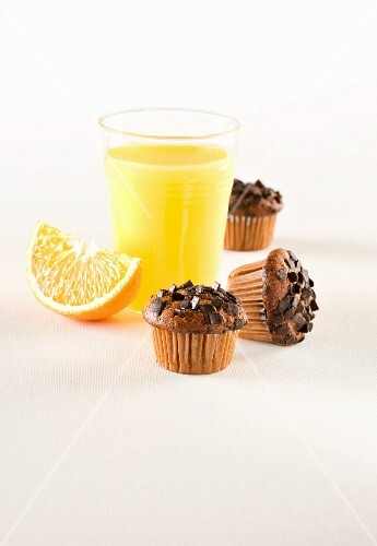 Muffins with chocolate sprinkles; served with freshly squeezed orange juice