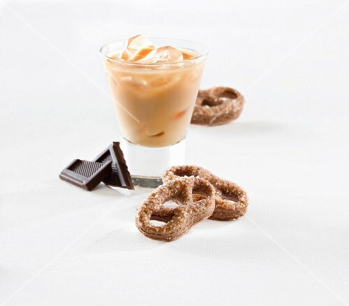 Chocolate pretzels and a cold caffè latte over ice