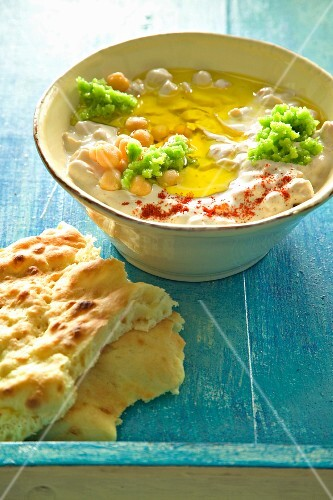 Houmous and tahini with olive oil, served with pita bread