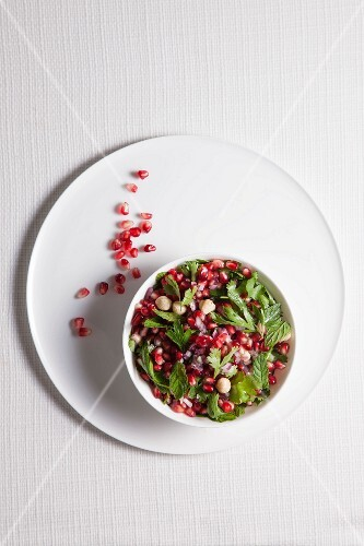 Pomegranate salad with herbs and hazelnuts
