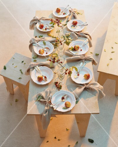 A table laid for a meal with autumnal decorations