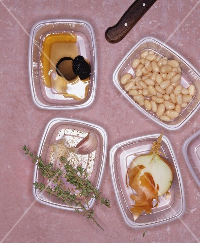 Plastic containers holding assorted ingredients for a savoury dish