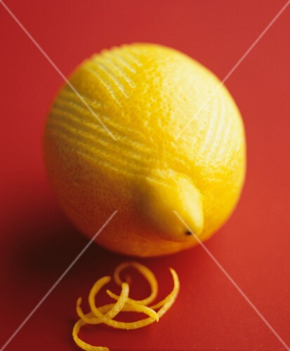 A lemon with grated zest