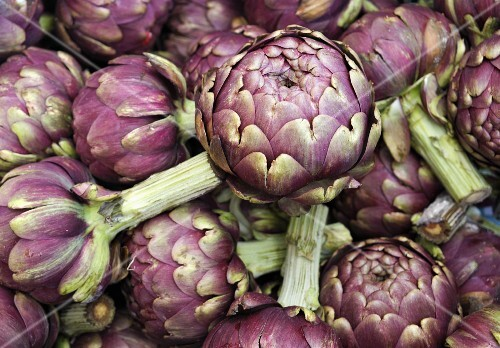 Lots of purple artichokes at the market