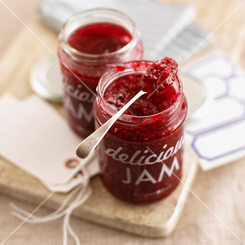 Raspberry-vanilla marmalade in a jar with a spoon