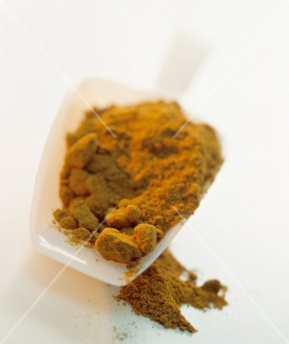 Paprika powder in a scoop