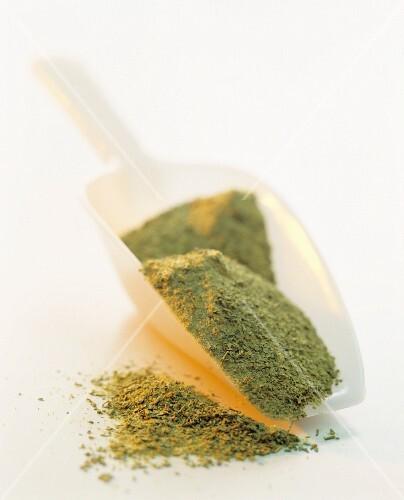 Green tea powder in a scoop
