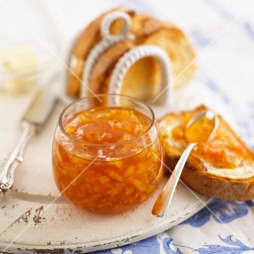 Orange marmalade with ginger, slices of toast