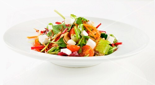 Vegetable salad with tomatoes, carrots and turnips