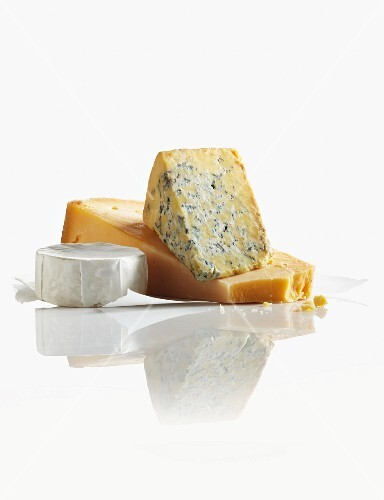 Three Assorted Cheeses on a White Background