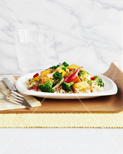 Tofu and vegetable stir-fry on rice