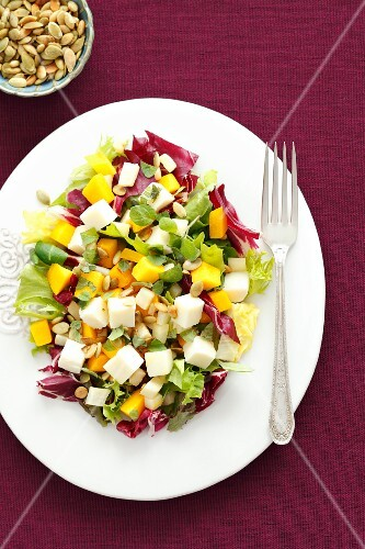 Salad with baked squash, feta, red endive and celery