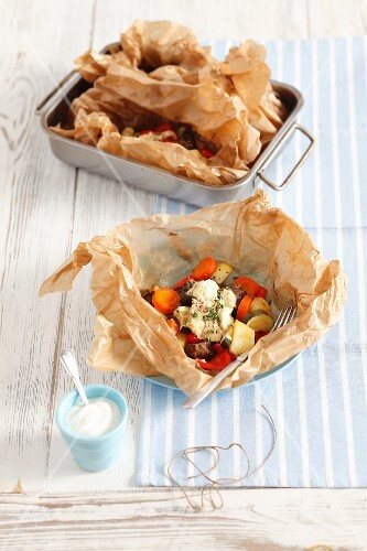 Kleftiko with pork, vegetables and ewe's cheese wrapped in baking parchment