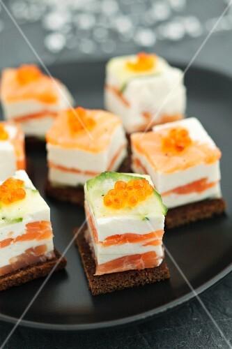 Salmon terrine with cream cheese, cucumber and caviar
