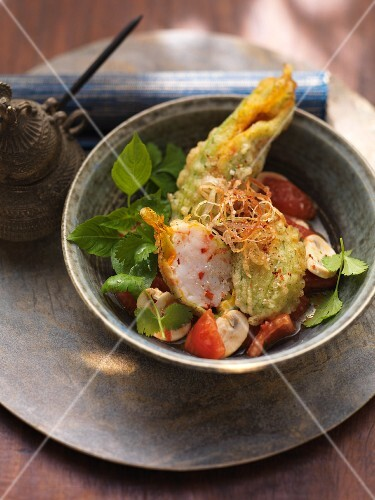 Courgette flowers filled with prawns and scallops in herb tempura batter