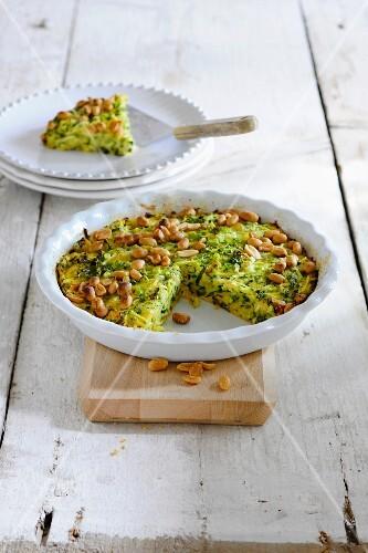 Courgette quiche with peanuts