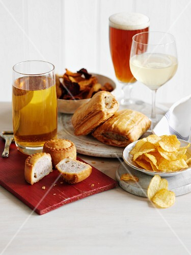 Assorted snacks with beer and cider