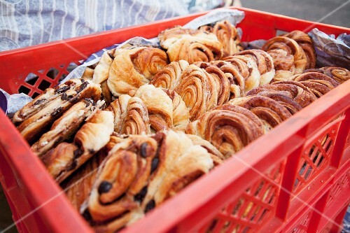 A crate of Danish pastries at a bakery