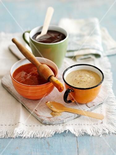 Three different marinades in bowls
