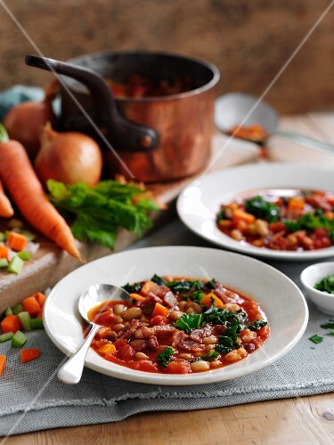 Bean soup with bacon, carrots and celery