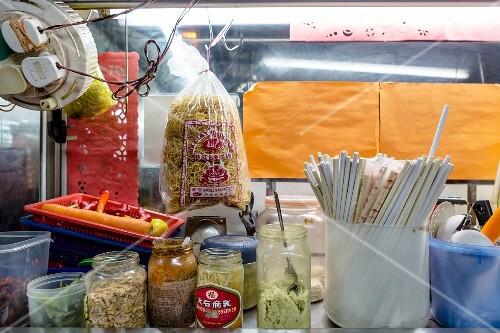 Food and chopsticks at a noodle bar (Kuala Lumpur, Malaysia)