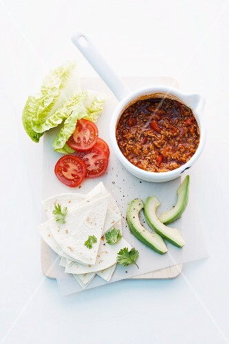 Spicy minced meat sauce, avocado and tortilla