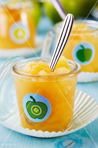 Glasses of apple sauce decorated with apple stickers