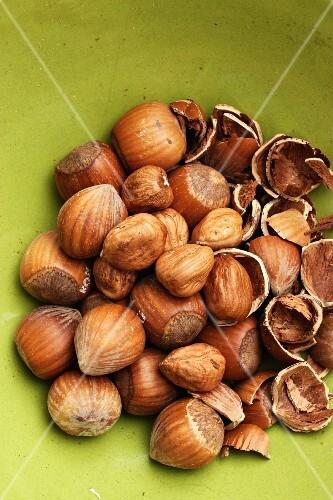 Lots of hazelnuts, whole and broken open