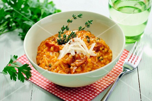 Tomato Risotto with dried Tomatoes and Thyme, selective focus