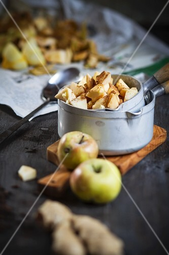 Chopped apples in a pan with spices and ginger