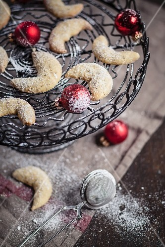 Vanilla crescents with Christmas baubles on a cake plate