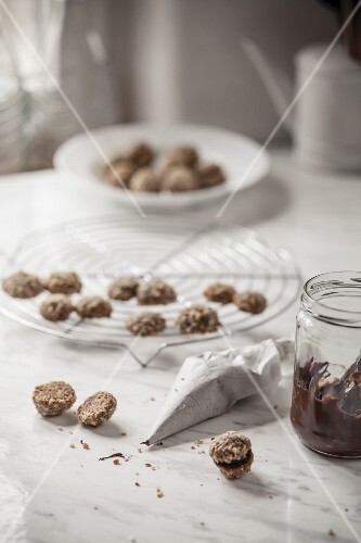 Espresso and walnut cookies being filled with nut nougat cream