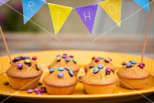 Muffins with chocolate beans and bunting for a child's birthday