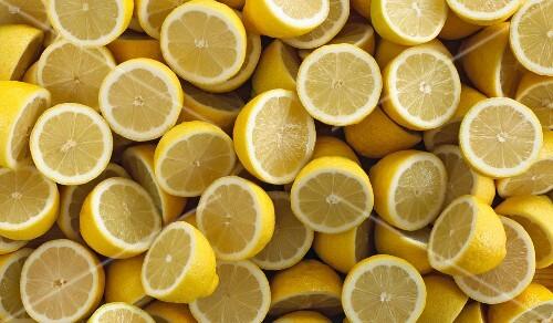 Lots of lemons cut in half (filling the image)