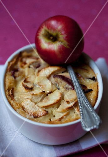 Apple clafoutis in a baking tin