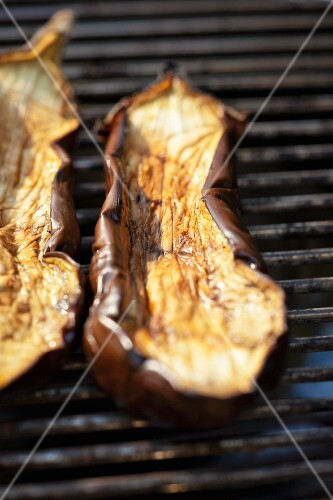 Slices of aubergine on the barbecue
