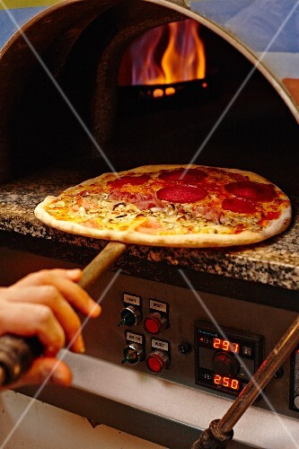 Pizza in the baking oven