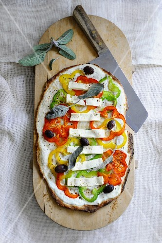 Flatbread topped with cream cheese, peppers, feta and sage