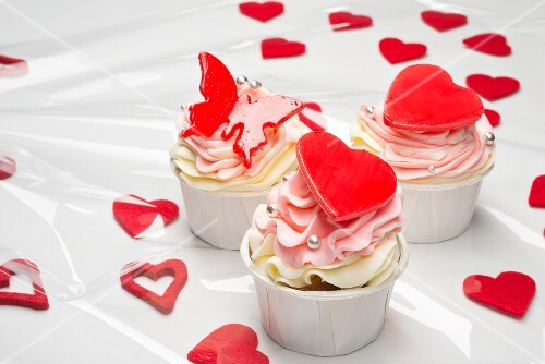 Pink cupcakes with red hearts and butterflies