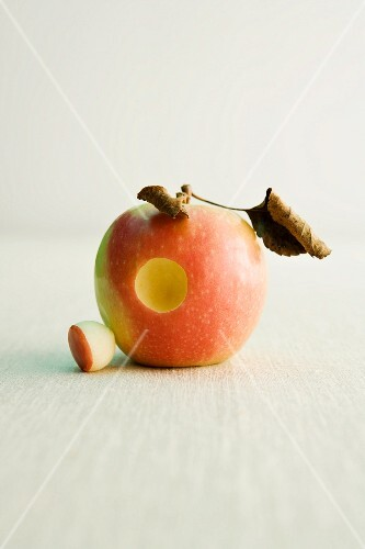 Pink Lady apple with a round hole