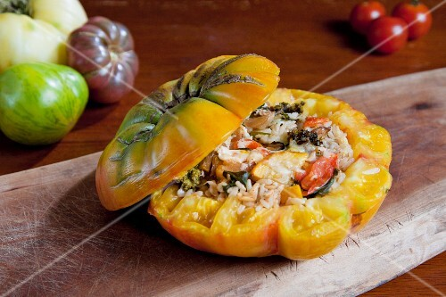 A Stuffed Heirloom Tomato with Rice, Yellow Squash, Broccoli, Onion, Basil and Parmesan Cheese