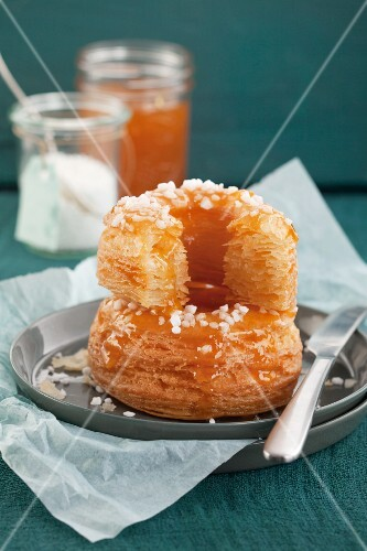 Apricot doughnuts made from puff pastry with sugar crystals