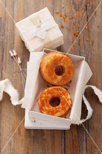 Caramel doughnuts with a cream filling as a gift