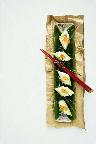Cucumber sushi with caviar on a serving platter (view from above)