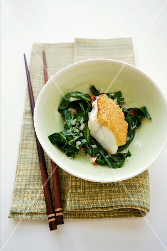 Fish fillet with a ginger crust on a bed of chard