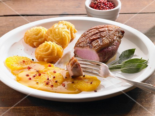Duck breast with orange sauce and pink peppercorns