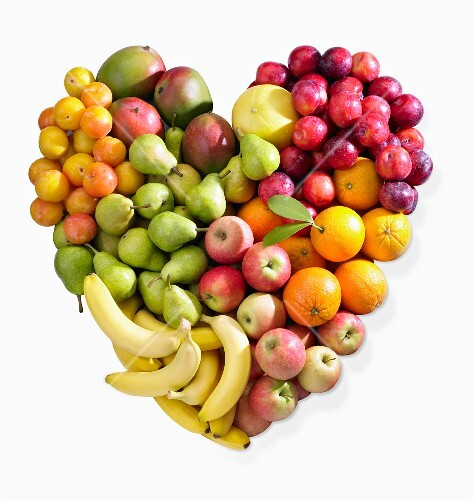 A fruit heart made of bananas, apples, pears, citrus fruits and plums