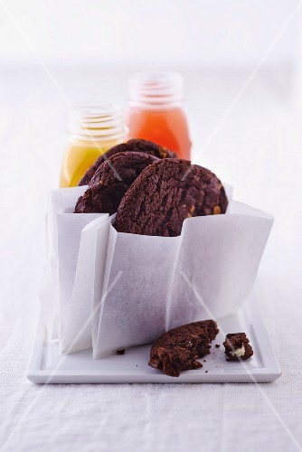 Chocolate biscuits and bottles of strawberry juice and of mango juice